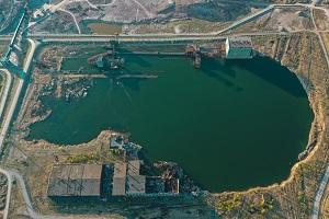 man made reservoir by an industrial site